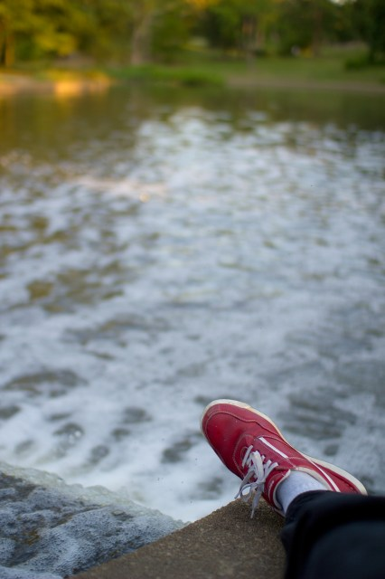 red shoe by the lake
