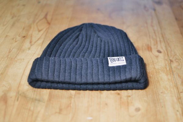 Navy toque with DMC logo tag on the cuff