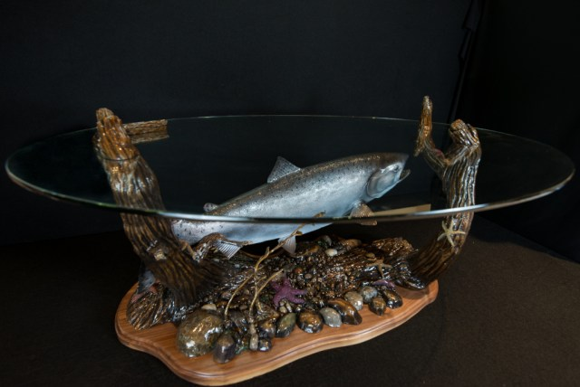 The bronze 'King Salmon Table' with a glass top with a king salmon and seabed below.