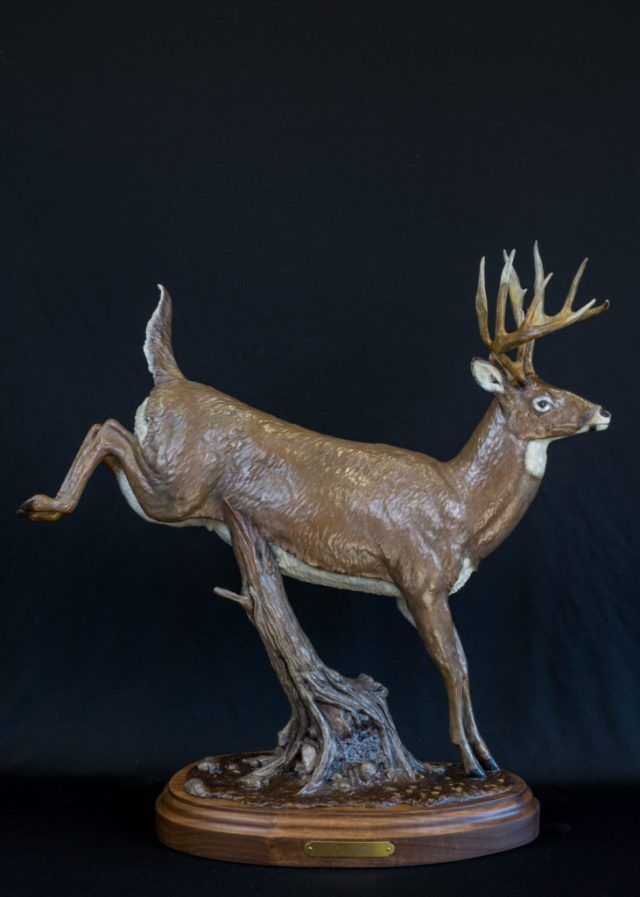 A white tail deer bounding away in the bronze 'The Escape'.