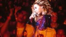 Beyoncé and Devin Torkelsen during her Chicago stop of the Mrs. Carter Show on her jumbotron