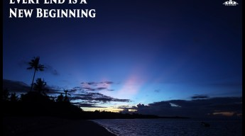 Postcard Warm regards from Devocean Pictures: Sunrise on south beach in Wakatobi, Indonesia with pink sun beams in dark blue sky. Text: Every end is a new beginning.
