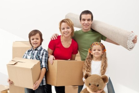 Family-with-children-moving-house-with-boxes-and-a-teddy