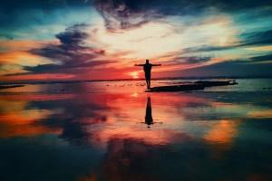 man standing at sunset
