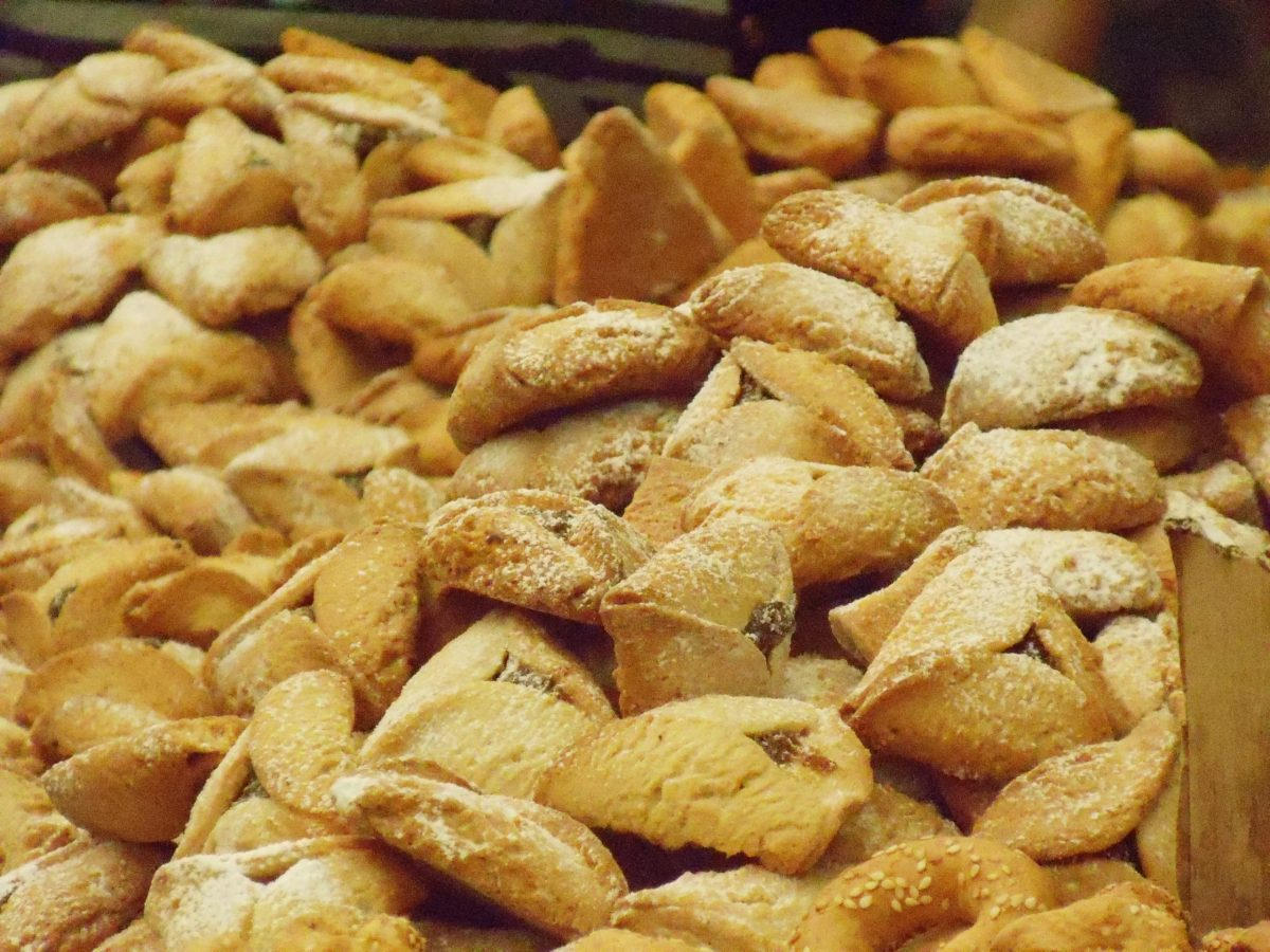 Many triangle shaped cookies in a pile.
