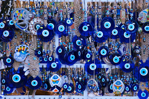 Many hanging evil eyes of different sizes and styles