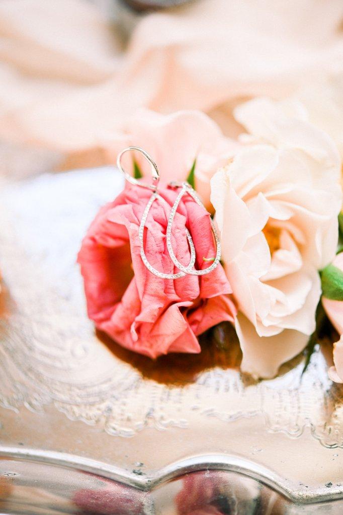 diamond tear drop earrings on flowers