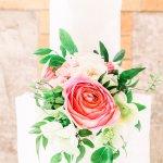 wedding cake with wedding flowers