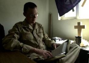 Chaplain reads Bible - Wikimedia - US Govt. Public Domain
