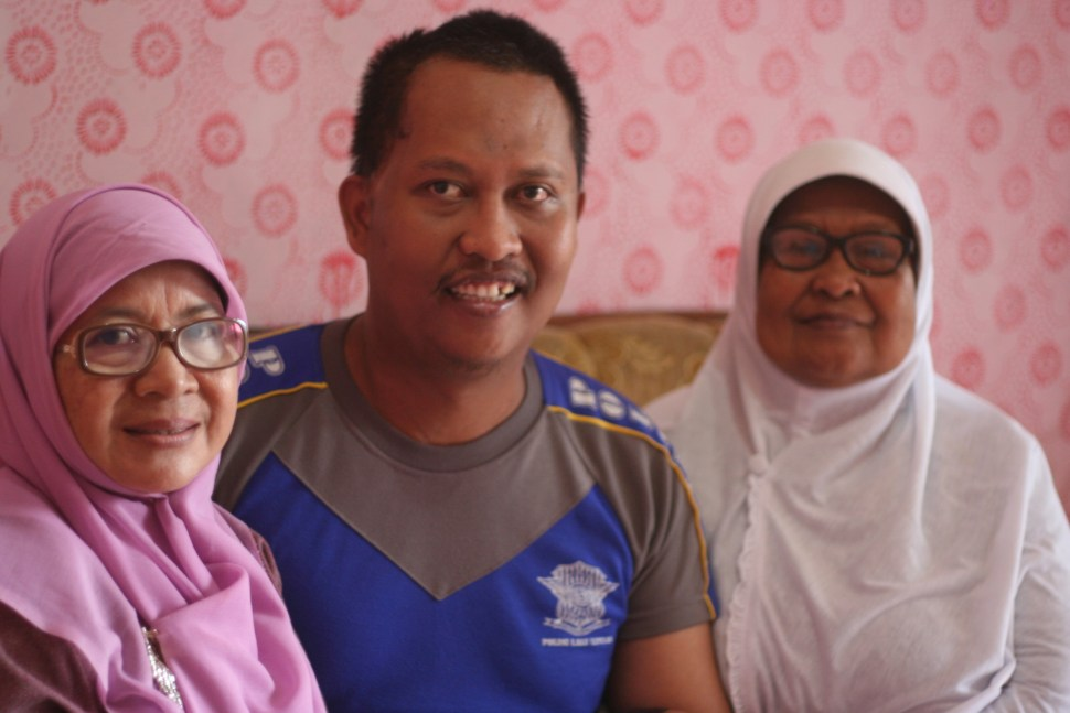 Asep says he feels like he has two mums: his mother, Epong (right), and Ema (left), who has supported him through his recovery.