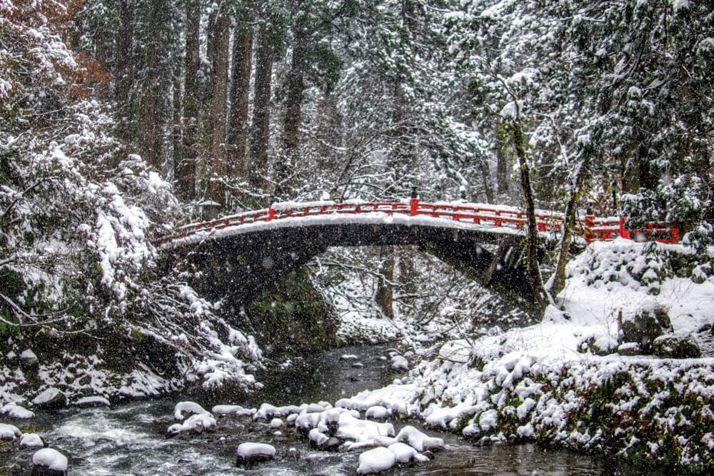 Shinkyo Bridge over the Haraigawa River at the base of Mt. Haguro of the Dewa Sanzan in the deep snow
