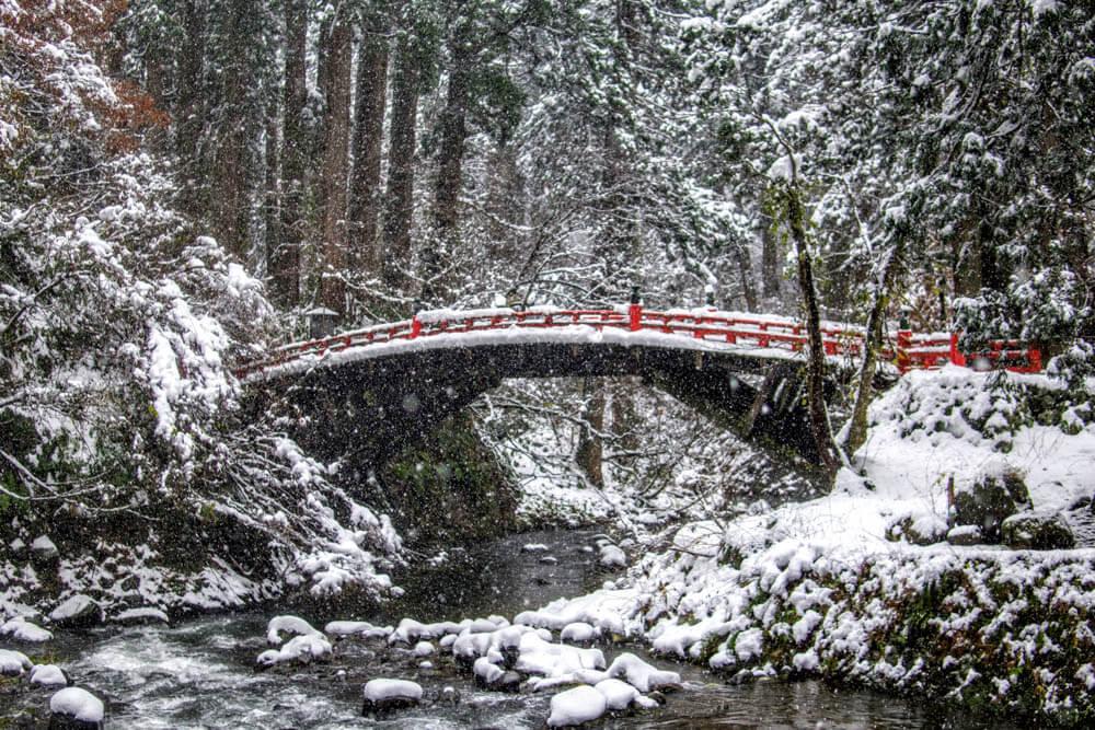 Shinkyo Bridge over the Haraigawa River at the base of Mt. Haguro of the Dewa Sanzan in the deep snow