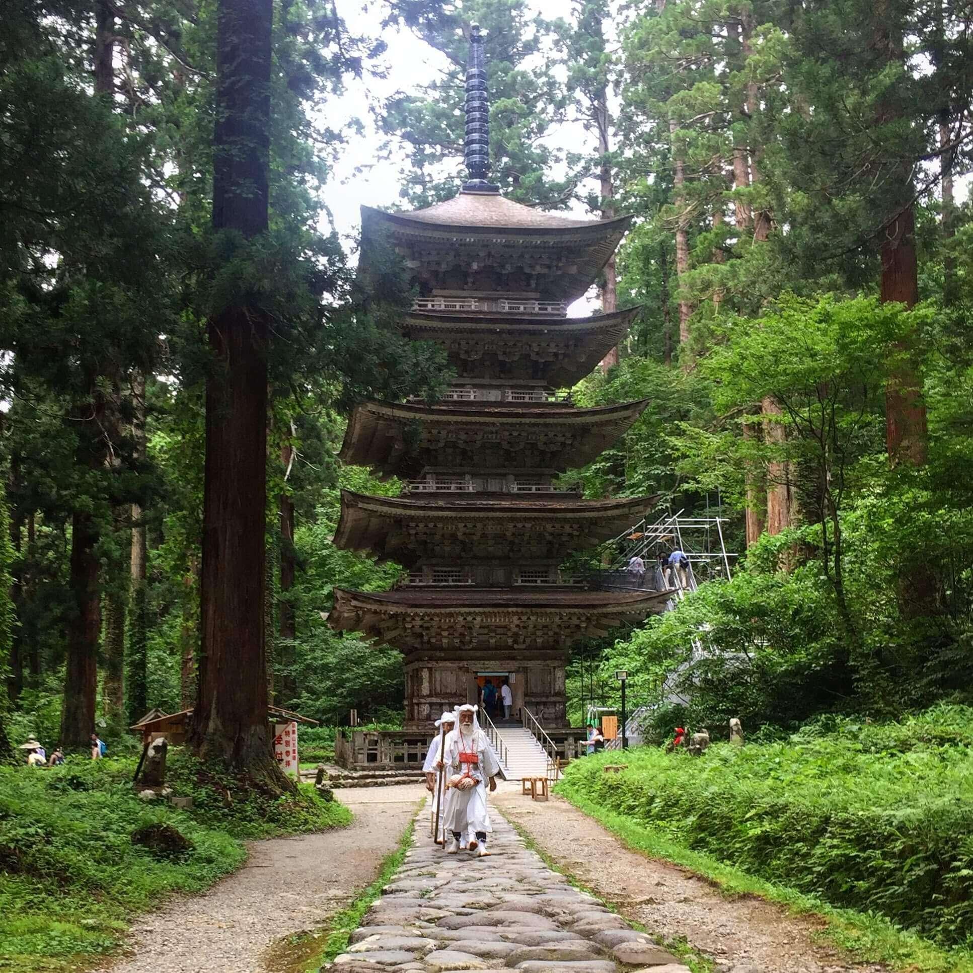 Yamabushi training near the Five Story Pagoda on Mt. Haguro of the Dewa Sanzan