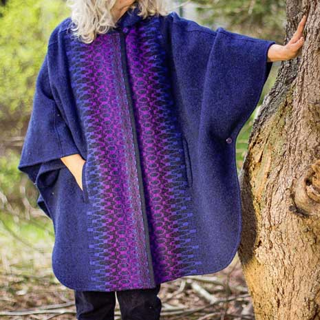 Short wool cape with hood shown in Royal & Plum