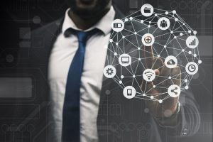 """A man in a business suite shows with a finger on the """"plus"""" icon. connected icons of IoT devices"""