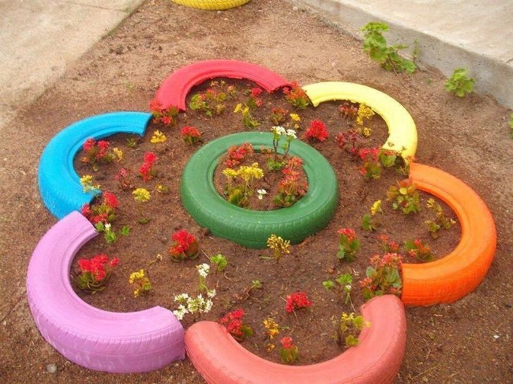 Bright flower bed of old tires