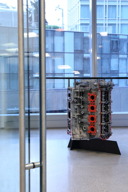 Press kit | 2073-01 - Press release | DIALOG awarded 'Best Tenant Improvement' for LGM's Vancouver Head Office - DIALOG - Commercial Interior Design - One of LGM's car engine tables<br> - Photo credit: Ema Peter <br>