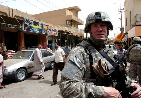1024px-US_Navy_080607-N-1765B-278_Lt._Cmdr._Doug_Kunzman_visits_the_marketplace_in_Ramadi_to_meet_with_business_owners_to_discuss_electricity_availability