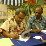 028. Jacob Rumbiak signing Unity Day Declaration with Chief Daniel Molisa (Port Vila Council of Chiefs)