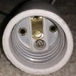 When the brass tab in the center of a light socket gets mashed down, it causes problems. Bend the tab up to at least a 20-degree angle. If it's badly discolored, it can also cause problems.