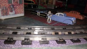 Nomura tin cars on train layout