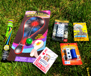gifts for sleep away campers glow sticks, light up paddle ball, playing cards, games and trading cards for camp by DFFrentFocus.com