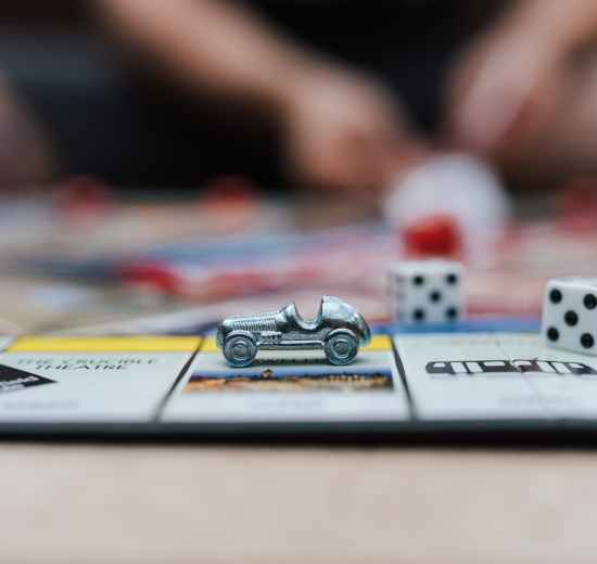 decorative automobile on game board on table