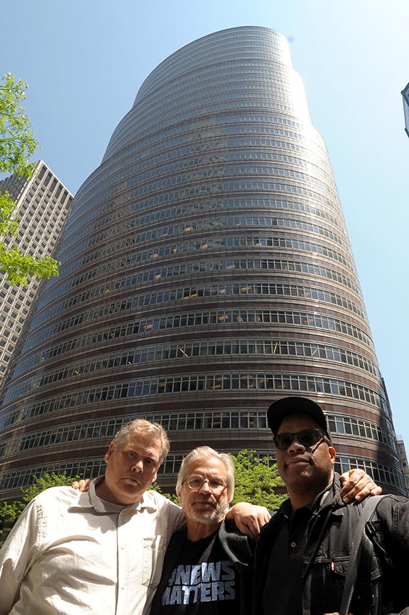 DFM journalists Thomas Peele, Karl Mondon, and George Kelly flew 3000 miles to protest at Alden Global Capitol headquarters last May. | Karl Mondon