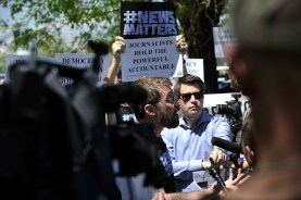 Denver Post reporter John Wenzel, center, speaks to members of the media on Tuesday, May 8, 2018 outside the paper's office and printing plant in north Denver. (Photo by Patrick Traylor)