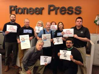 Staff at the St. Paul Pioneer Press show their support for Denver Post and other journalists delivering the truth to Alden.