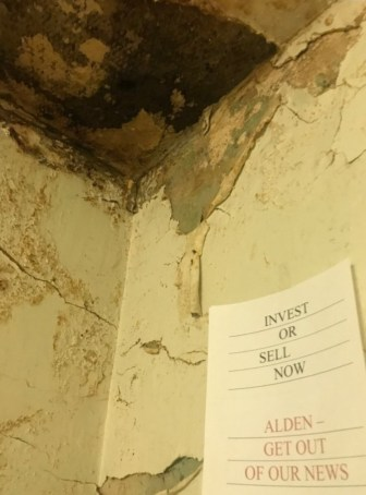 Ceiling and a sign about Alden