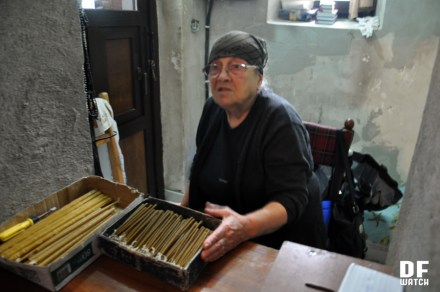 Guguli is selling candles at one of churches in Batumi (DFWatch photo)
