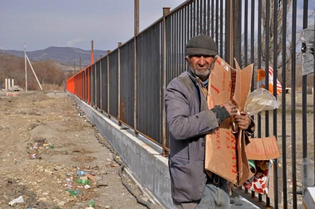 Homeless man collecting stuff from emptied market (Mari Nikuradze)