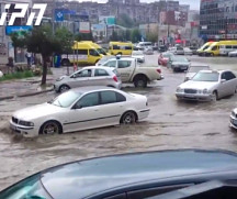Swimming cars on Hero's Square in Tbilisi following strong rain