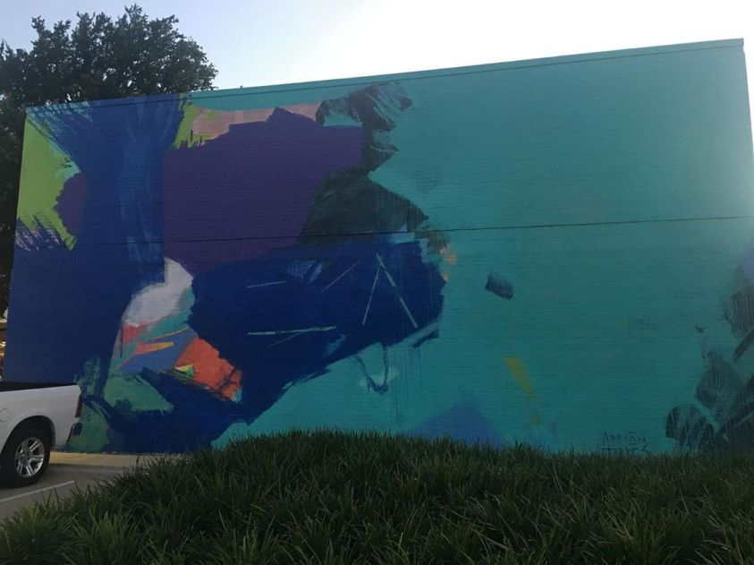 An abstract work by muralist Adrian Torres of a stylized ocean wave at Legacy Central in Plano
