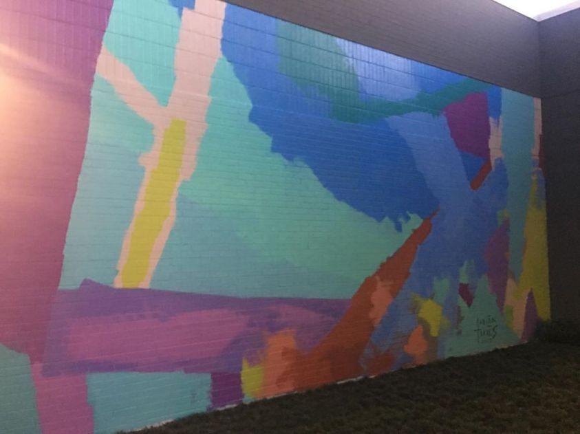 A large abstract mural of formless shapes in an enclave at Legacy Central in Plano