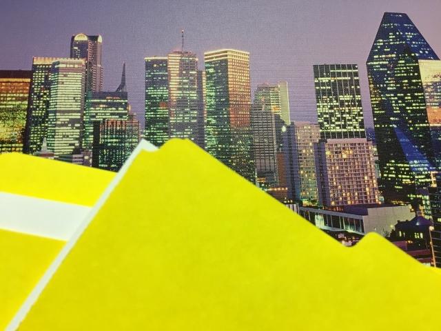 Manila folders over Dallas skyline image