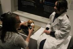 Becca Peixotto, Ph. D, explains the virtual reality experience to Katy Ottwell.
