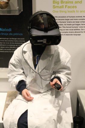 Katy Ottwell experiences the virtual reality of the homo naledi chamber.