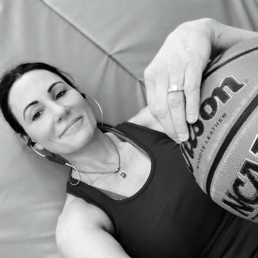 DGA founder Tara Mogan Blom holding a basketball