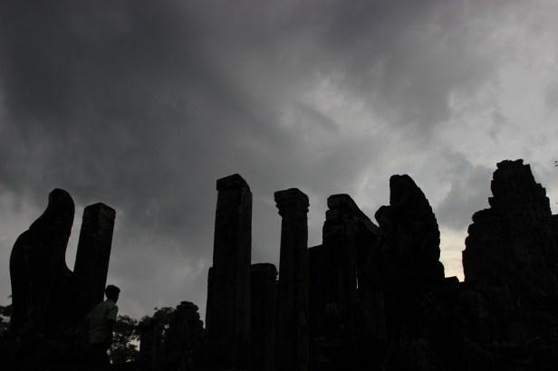 Sunset at Angkor Thom. A tour group scrambles to see the ruins before dark.