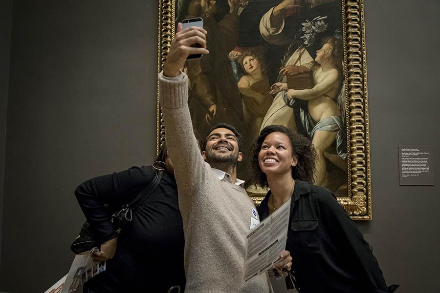 A team takes a scavenger hunt selfie.