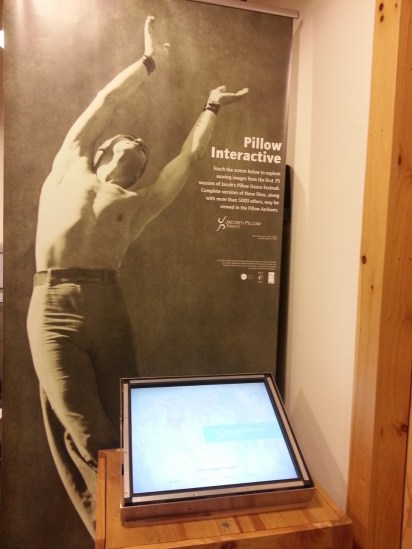 This beautiful poster of Ted Shawn dancing is seen behind a kiosk for accessing Dance Interactive video content.