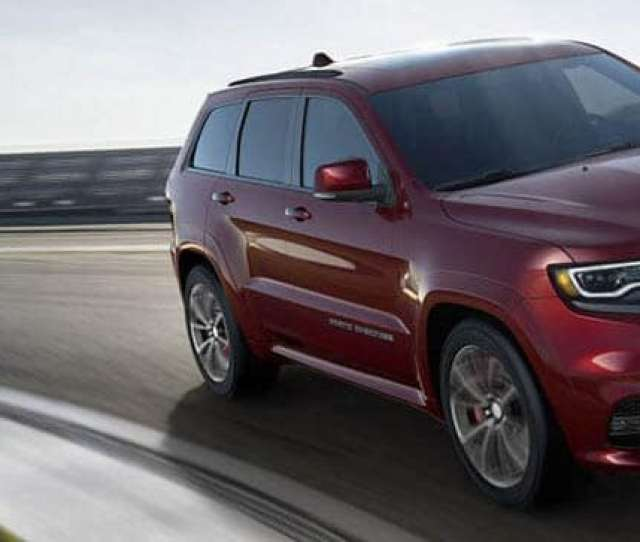 Jeep Grand Cherokee Driving On Race Track