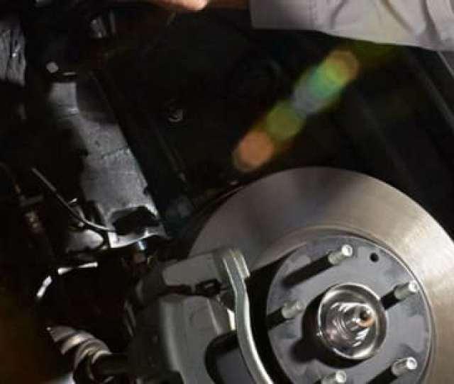 Technician Servicing Brakes