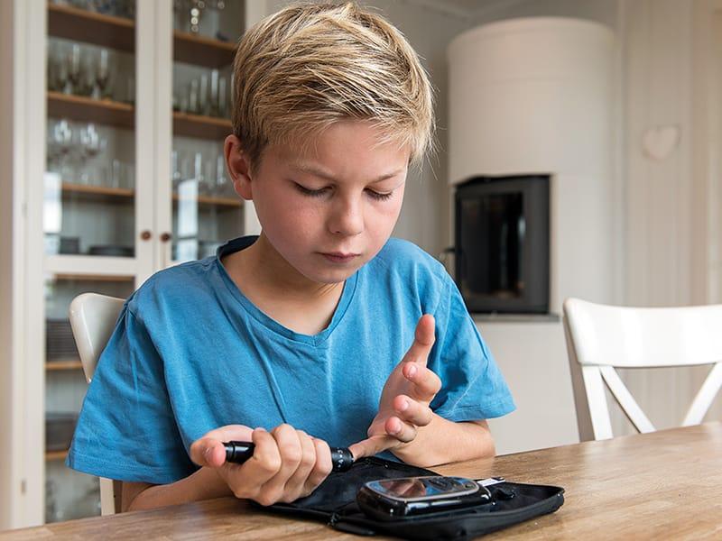 Child monitoring blood glucose