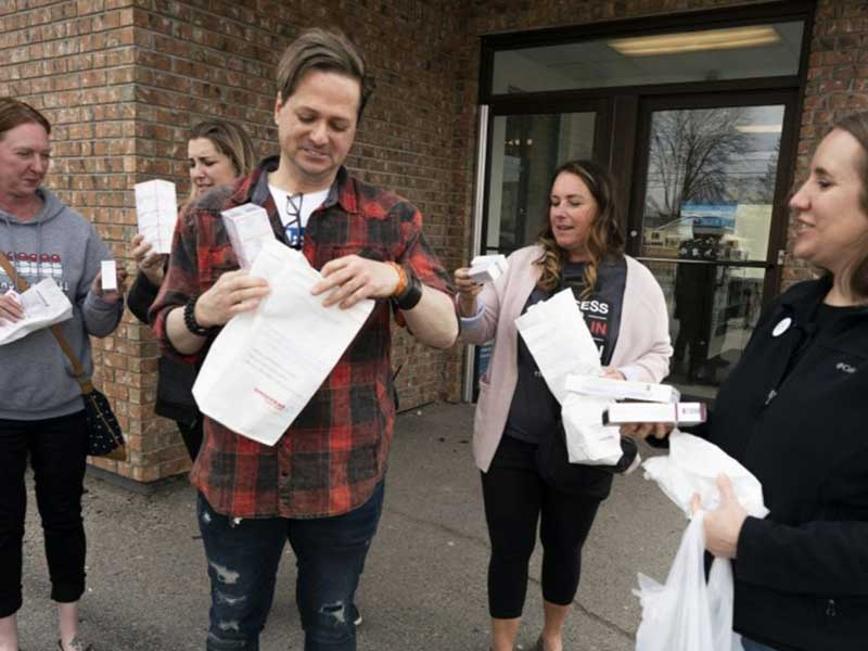 From left to right: Nicole Smith-Holt, Quinn Nystrom, Travis Paulson, Vicky Luedke, Lija Greenseid stand outside a Canadian pharmacy with 3-months supply of insulin (Saturday, May 4, 2019).