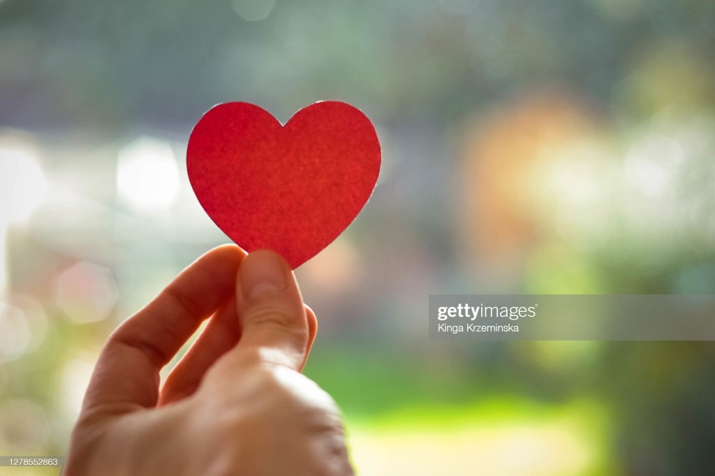 Paper heart in a hand