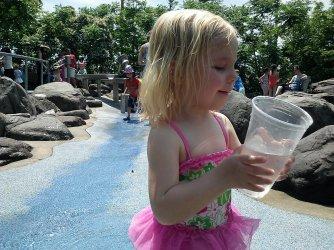 Fiona splashes around in the Water Lab at Pier 6 in Brooklyn Bridge Park.