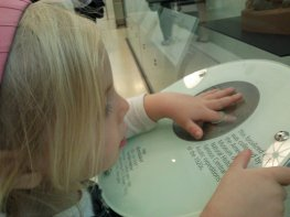 Fiona touches a dinosaur egg at the American Museum of Natural History, Manhattan.